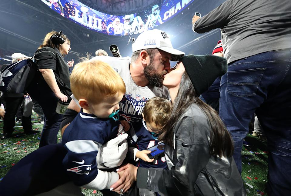 <p>James Develin #46 of the New England Patriots celebrates with his family after his teams 13-3 win over the Los Angeles Rams during Super Bowl LIII at Mercedes-Benz Stadium on February 03, 2019 in Atlanta, Georgia. (Photo by Al Bello/Getty Images) </p>