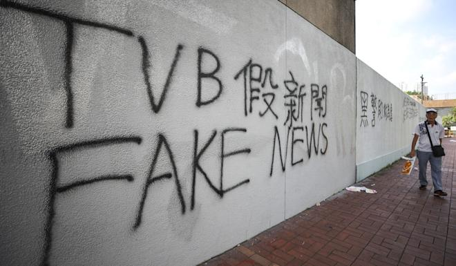 Protesters cover a wall with graffiti against TVB news coverage in Sha Tin. Photo: Winson Wong