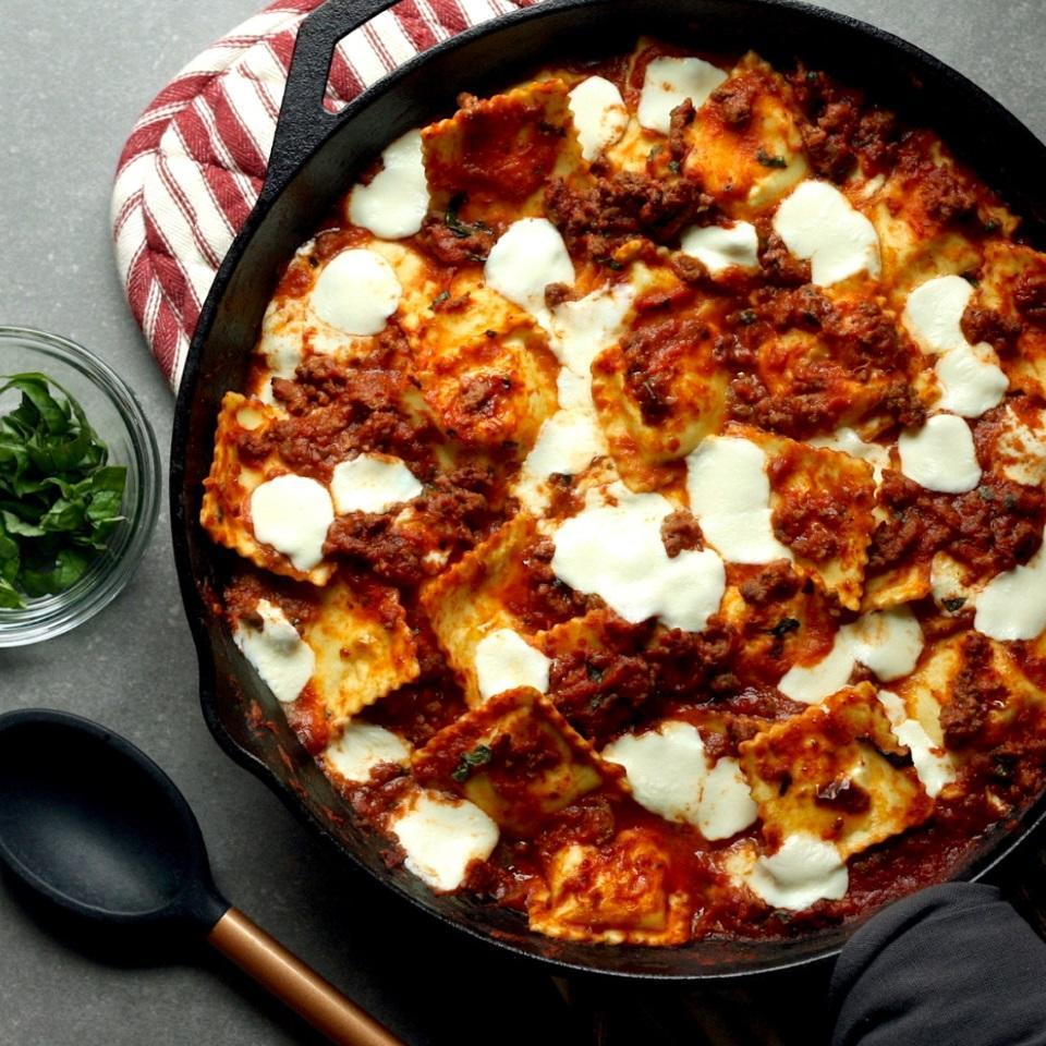 """<p>This easy inside-out ravioli lasagna is the ultimate weeknight comfort food--no layering or mixing bowls required. Feel free to swap in ground turkey for the beef. Look for fresh mozzarella balls (also called """"pearls"""") in the specialty cheese section of your grocery store. <a href=""""https://www.eatingwell.com/recipe/274006/skillet-ravioli-lasagna/"""" rel=""""nofollow noopener"""" target=""""_blank"""" data-ylk=""""slk:View Recipe"""" class=""""link rapid-noclick-resp"""">View Recipe</a></p>"""