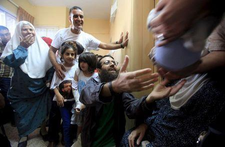 Islamic Jihad leader Khader Adnan is surrounded by his relatives upon his release from an Israeli jail, in the West Bank village of Arabeh near Jenin July 12, 2015. REUTERS/Stringer