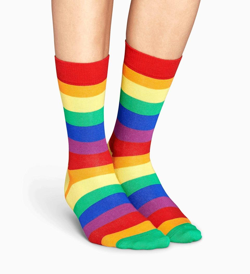 """<p><strong>Happy Socks</strong></p><p>happysocks.com</p><p><strong>$14.00</strong></p><p><a href=""""https://go.redirectingat.com?id=74968X1596630&url=https%3A%2F%2Fwww.happysocks.com%2Fus%2Fpride-sock.html&sref=https%3A%2F%2Fwww.goodhousekeeping.com%2Fclothing%2Fg32934454%2Fpride-clothing-apparel-accessories%2F"""" rel=""""nofollow noopener"""" target=""""_blank"""" data-ylk=""""slk:Shop Now"""" class=""""link rapid-noclick-resp"""">Shop Now</a></p><p>What's Pride Month without some fun rainbow socks?! Happy Socks x The Phluid Project have teamed up for a <a href=""""https://go.redirectingat.com?id=74968X1596630&url=https%3A%2F%2Fwww.happysocks.com%2Fus%2Fpride&sref=https%3A%2F%2Fwww.goodhousekeeping.com%2Fclothing%2Fg32934454%2Fpride-clothing-apparel-accessories%2F"""" rel=""""nofollow noopener"""" target=""""_blank"""" data-ylk=""""slk:collection of Pride-themed socks"""" class=""""link rapid-noclick-resp"""">collection of Pride-themed socks</a>, with 10 percent of net sales going to <strong><a href=""""https://www.thetrevorproject.org/"""" rel=""""nofollow noopener"""" target=""""_blank"""" data-ylk=""""slk:The Trevor Project"""" class=""""link rapid-noclick-resp"""">The Trevor Project</a></strong> to help support suicide prevention efforts for LGBTQ youth. </p><p><strong>RELATED: </strong><a href=""""https://www.goodhousekeeping.com/life/entertainment/g27814264/best-gay-lgbt-books/"""" rel=""""nofollow noopener"""" target=""""_blank"""" data-ylk=""""slk:35 Fantastic LGBT Books to Read This Pride Month"""" class=""""link rapid-noclick-resp"""">35 Fantastic LGBT Books to Read This Pride Month</a> </p>"""