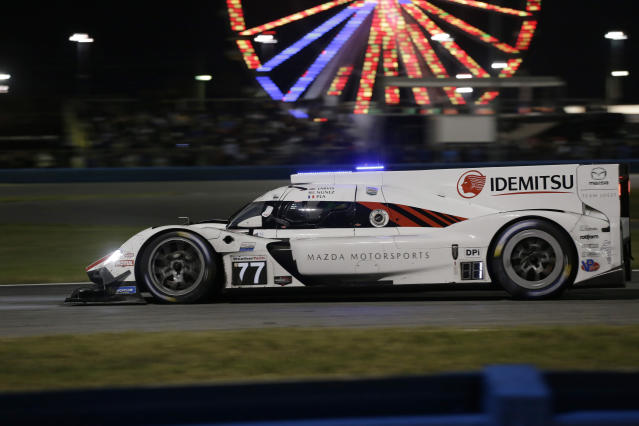 Mazda Team Joest driver Oliver Jarvis competes on the track during the Rolex 24-hour auto race at Daytona International Speedway, Saturday, Jan. 25, 2020, in Daytona Beach, Fla. (AP Photo/Terry Renna)