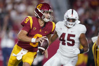 Southern California quarterback Kedon Slovis (9) runs out of the pocket as Stanford linebacker Ricky Miezan (45) pursues during the first half of an NCAA college football game Saturday, Sept. 11, 2021, in Los Angeles. (AP Photo/Marcio Jose Sanchez)