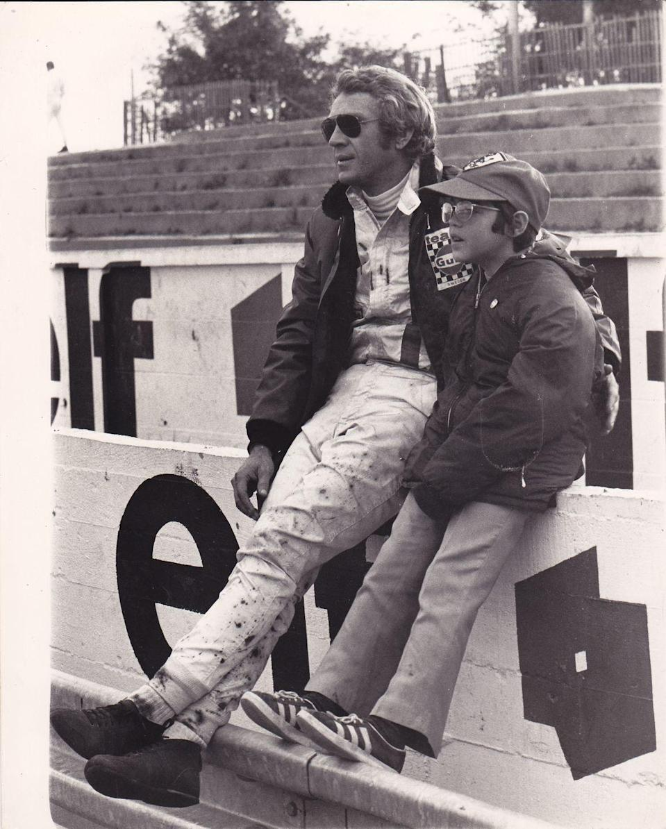 <p>Steve McQueen brings his son Chad to his set at the race track while he films <em>Les Mans </em>in France in 1971. </p>