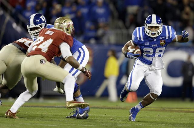 Duke's Shaquille Powell (28) runs as Florida State's Terrance Smith (24) defends in the first half of the Atlantic Coast Conference Championship NCAA football game in Charlotte, N.C., Saturday, Dec. 7, 2013. (AP Photo/Bob Leverone)