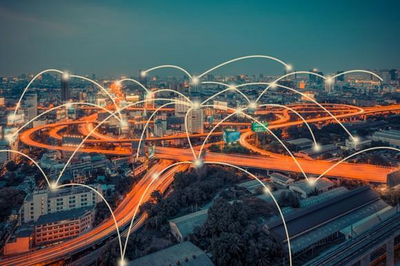 Cityscape with connected nodes indicating wireless communication.