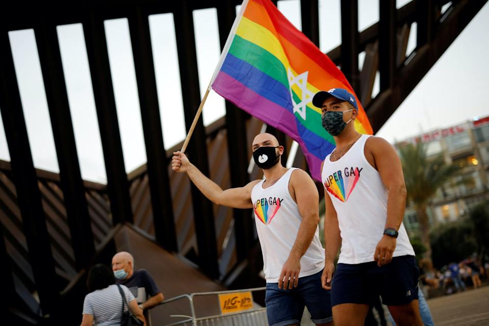 People take part in a Gay Pride event which has been down-scaled amid coronavirus disease (COVID-19) fears, at Rabin square in Tel Aviv, Israel June 28, 2020.
