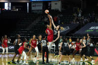 Las Vegas Aces' Liz Cambage (8) tips-off against Seattle Storm's Breanna Stewart to start the first half of a WNBA basketball game and their season Saturday, May 15, 2021, in Everett, Wash. (AP Photo/Elaine Thompson)