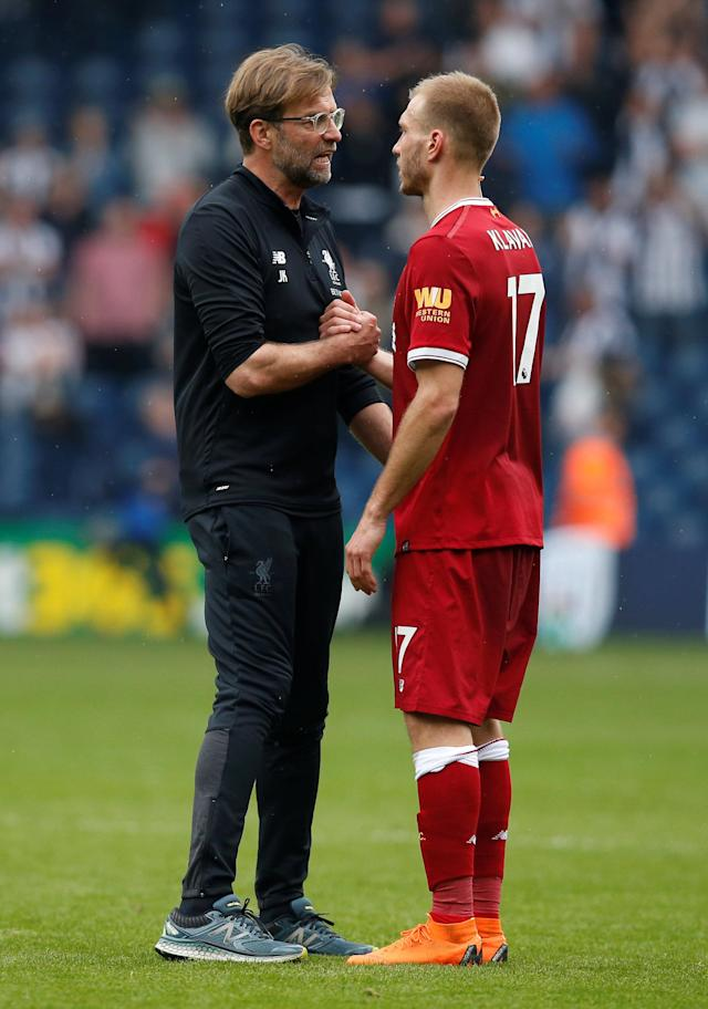 """Soccer Football - Premier League - West Bromwich Albion v Liverpool - The Hawthorns, West Bromwich, Britain - April 21, 2018 Liverpool manager Juergen Klopp and Ragnar Klavan after the match REUTERS/Andrew Yates EDITORIAL USE ONLY. No use with unauthorized audio, video, data, fixture lists, club/league logos or """"live"""" services. Online in-match use limited to 75 images, no video emulation. No use in betting, games or single club/league/player publications. Please contact your account representative for further details."""