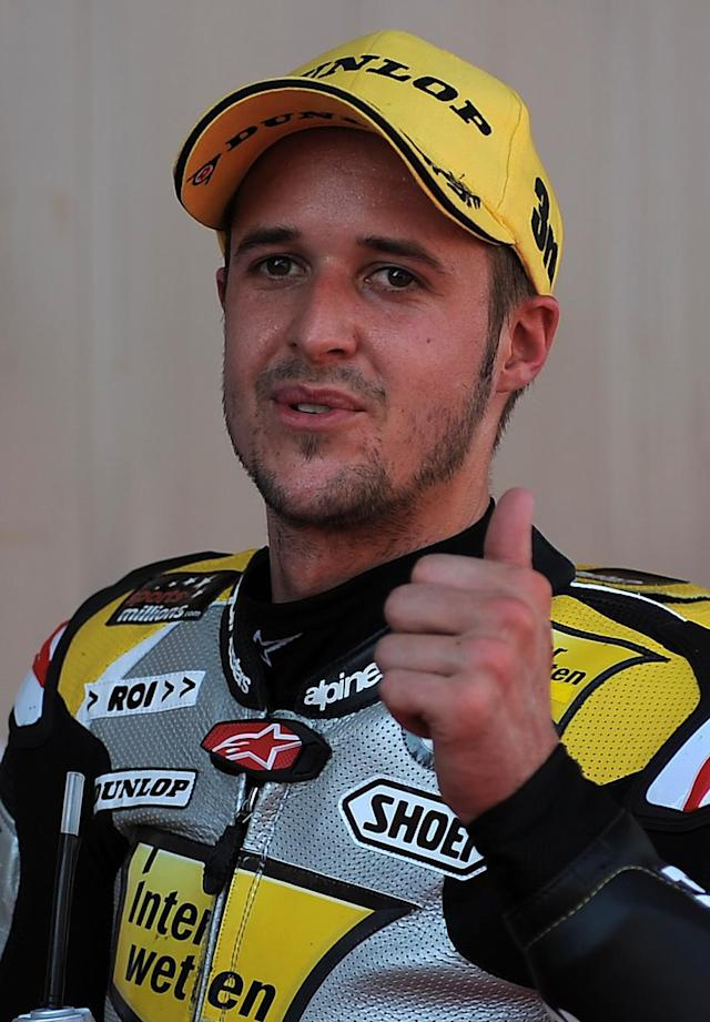 Interwetten-Paddock's Swiss Thomas Luthi celebrates at the Catalunya racetrack in Montmelo, near Barcelona, on June 2, 2012, during the Moto2 qualifying session of the Catalunya Moto GP Grand Prix. Luthi took the third position.AFP PHOTO/LLUIS GENELLUIS GENE/AFP/GettyImages