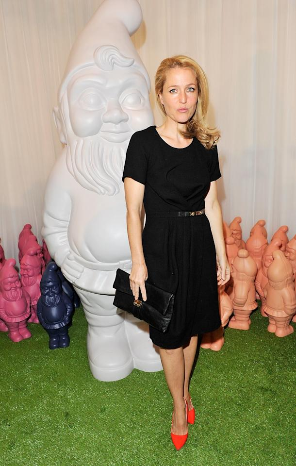 "<p class=""MsoNormal""><span>Gillian Anderson managed to remain completely serious despite being surrounded by gnomes at the Mulberry Spring Summer 2013 Show at Claridge's. <br></span></p><p class=""MsoNormal""><span>(Photo by Dave M. Benett/Getty Images)</span></p>"