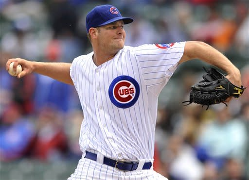 Chicago Cubs starter Chris Volstad delivers a pitch against the St. Louis Cardinals in the first inning of a baseball game in Chicago, Wednesday, April 25, 2012. (AP Photo/Paul Beaty)