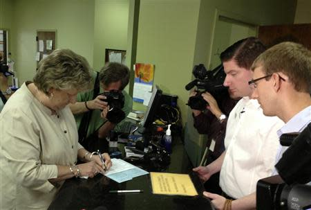 Trey Goff (2nd R) and Matthew Sheffield (R) apply for a marriage license in Tupelo, Mississippi, July 18, 2013, in this photo courtesy of Aaron Sarver. REUTERS/Aaron Sarver/Handout via Reuters
