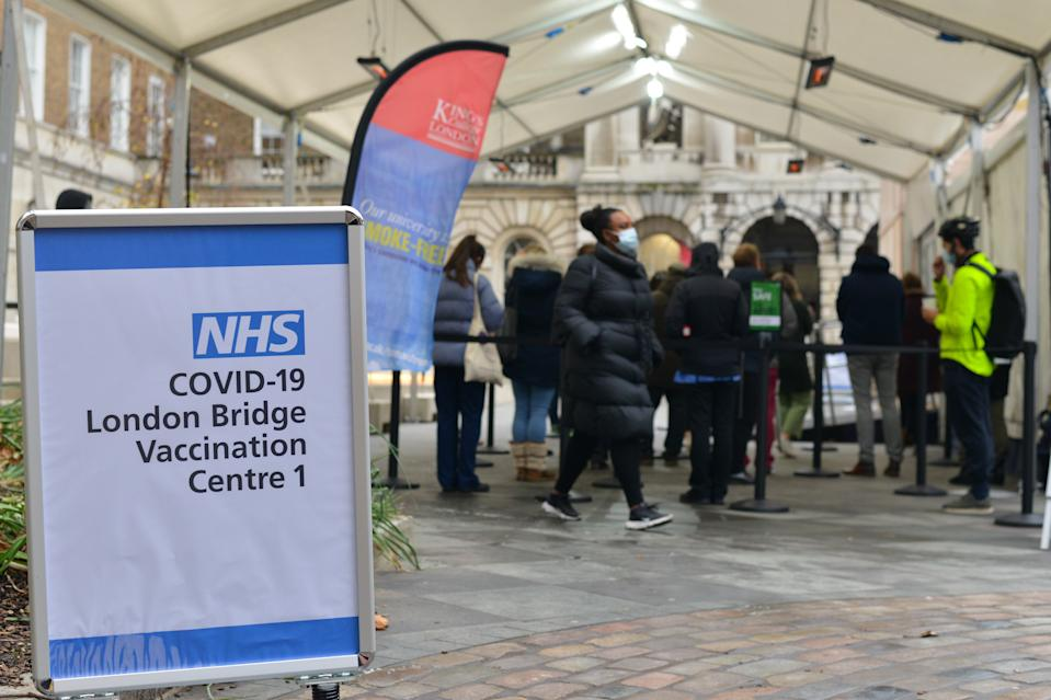 LONDON, UNITED KINGDOM - 2021/01/04: People queue at NHS Covid-19 vaccination centre in London as cases of the virus continue to soar. (Photo by Thomas Krych/SOPA Images/LightRocket via Getty Images)