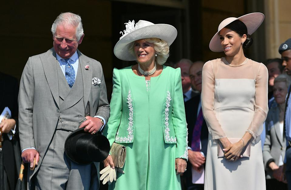 LONDON, ENGLAND - MAY 22:  Prince Charles, Prince of Wales, Camilla, Duchess of Cornwall and Meghan, Duchess of Sussex attend The Prince of Wales' 70th Birthday Patronage Celebration held at Buckingham Palace on May 22, 2018 in London, England.  (Photo by Dominic Lipinski - Pool/Getty Images)