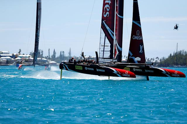 Sailing - America's Cup finals - Hamilton, Bermuda - June 25, 2017 - Emirates Team New Zealand leads Oracle Team USA arounds a mark in race eight of America's Cup finals . REUTERS/Mike Segar