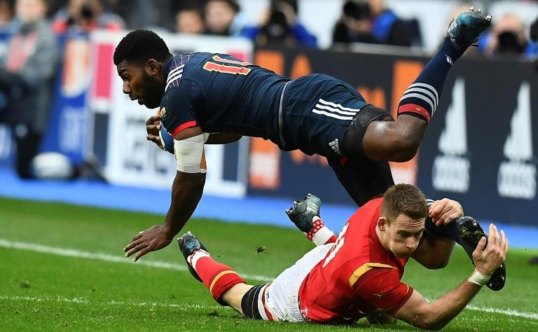 France's left wing Noa Nakaitaci (L) is tackled by Wales' left wing Liam Williams during the Six Nations international rugby union match March 18, 2017