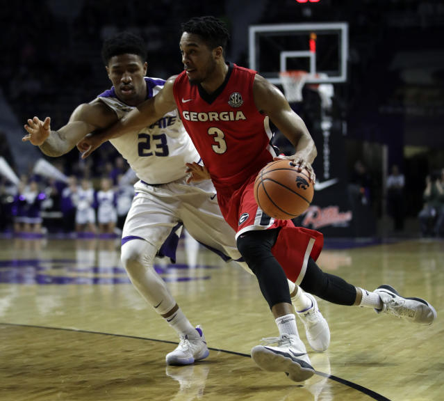 Kansas State G Amaad Wainright (L) was arrested April 3 and charged with two felonies. (AP Photo/Orlin Wagner)