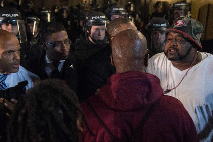 Civil rights leaders try to calm down protesters in front of riot police during a demonstration in Charlotte, North Carolina on Thursday over the fatal police shooting of a black man (AFP Photo/Nicholas Kamm)