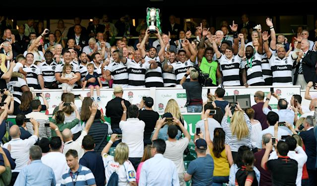 Rugby Union - England v Barbarians, Twickenham Stadium, London, Britain - May 27, 2018 Barbarians' Juan Martin Fernandez Lobbe lifts the trophy as they celebrate after victory Action Images via Reuters/Tony O'Brien