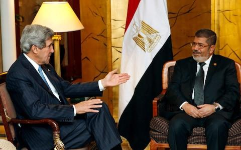 Mohammed Morsi in a meeting with then US Secretary of State, John Kerry, in 2013 - Credit: Jim Young/Reuters