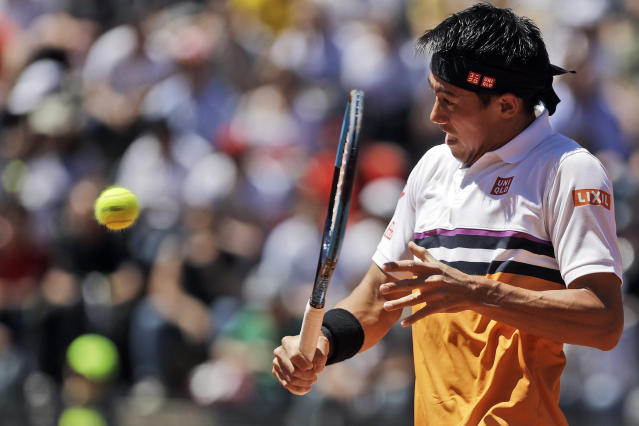 Japan's Kei Nishikori returns the ball during his match against Taylor Fritz, of the United States, at the Italian Open tennis tournament, in Rome, Thursday, May, 16, 2019. (AP Photo/Gregorio Borgia)