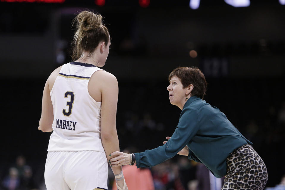 Notre Dame head coach Muffet McGraw, right, speaks with guard Marina Mabrey (3) during the first half in a regional semifinal at the NCAA women's college basketball tournament against Texas A&M, Saturday, March 24, 2018, Spokane, Wash. (AP Photo/Young Kwak)