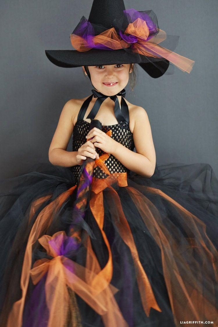 """<p>Another purple, orange, and black option, this DIY is gorgeously spooky (and a great dress f0r twirling too).</p><p><strong>Get the tutorial at <a href=""""https://liagriffith.com/kids-diy-witch-costume/"""" rel=""""nofollow noopener"""" target=""""_blank"""" data-ylk=""""slk:Lia Griffith"""" class=""""link rapid-noclick-resp"""">Lia Griffith</a>. </strong> </p><p><a class=""""link rapid-noclick-resp"""" href=""""https://www.amazon.com/Expo-Classic-Tulle-25-Yard-Orange/dp/B007Q2JIMG/ref=sr_1_3?tag=syn-yahoo-20&ascsubtag=%5Bartid%7C10050.g.28304812%5Bsrc%7Cyahoo-us"""" rel=""""nofollow noopener"""" target=""""_blank"""" data-ylk=""""slk:SHOP ORANGE TULLE"""">SHOP ORANGE TULLE</a> </p>"""