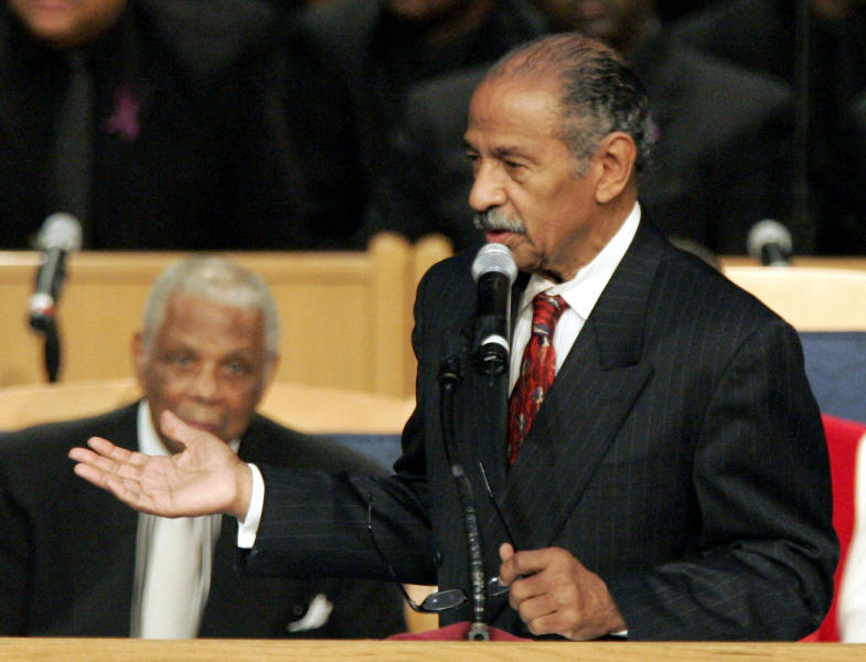 FILE - In a Nov. 2, 2005 file photo, Congressman John Conyers, D-Mich., speaks at the funeral for civil rights pioneer Rosa Parks in Detroit. Detroit police say the former congressman died at his home on Sunday, Oct. 27, 2019. He was 90. ( (AP Photo/Carlos Osorio, File)