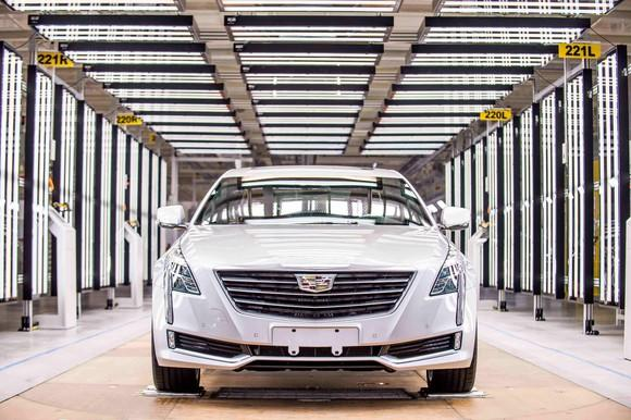 A white Cadillac CT6 luxury sedan in the final inspection area of GM's Shanghai factory.
