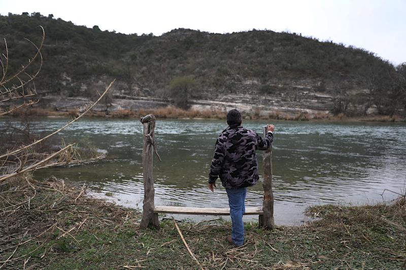 DEL RIO, TEXAS - JANUARY 18: Leonel Calderon stands next to the Rio Grande river, which marks the boundary between the United States and Mexico, as it flows past the back yard of his home on January 18, 2019 in Del Rio, Texas. The U.S. government is partially shut down as President Donald Trump is asking for $5.7 billion to build additional walls along the U.S.-Mexico border and the Democrats oppose the idea. Mr. Calderon said, ' I think the wall is idiotic and would not want the U.S. government to take the land I have lived on for 10 years by eminent domain powers to make way for the wall.' (Photo by Joe Raedle/Getty Images)