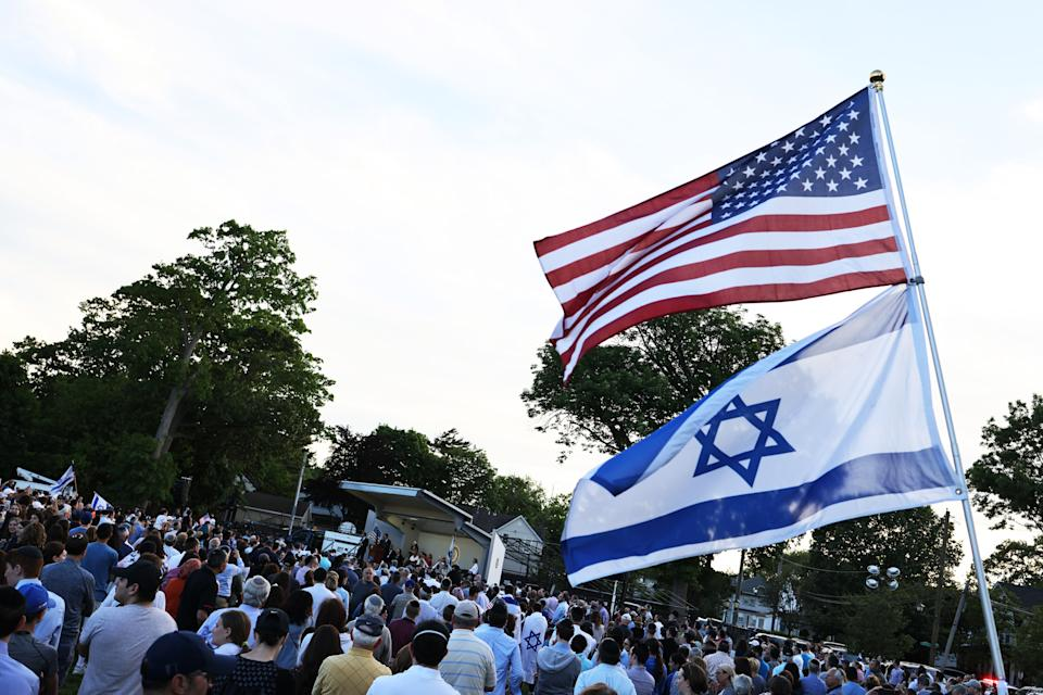 People attend a rally denouncing antisemitic violence