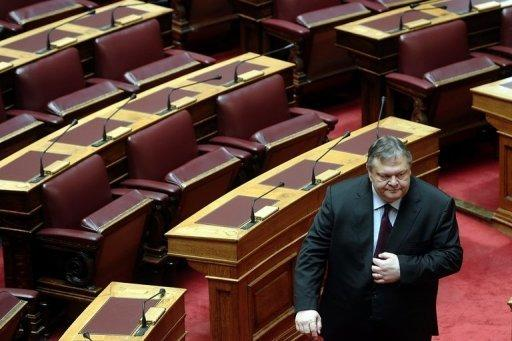 Greece's Socialist Party Leader Evangelos Venizelos leaves the Greek parliament after a swearing-in ceremony in Athens on May 17. His debt-stricken country topped the world agenda as leaders went into talks with US President Barack Obama