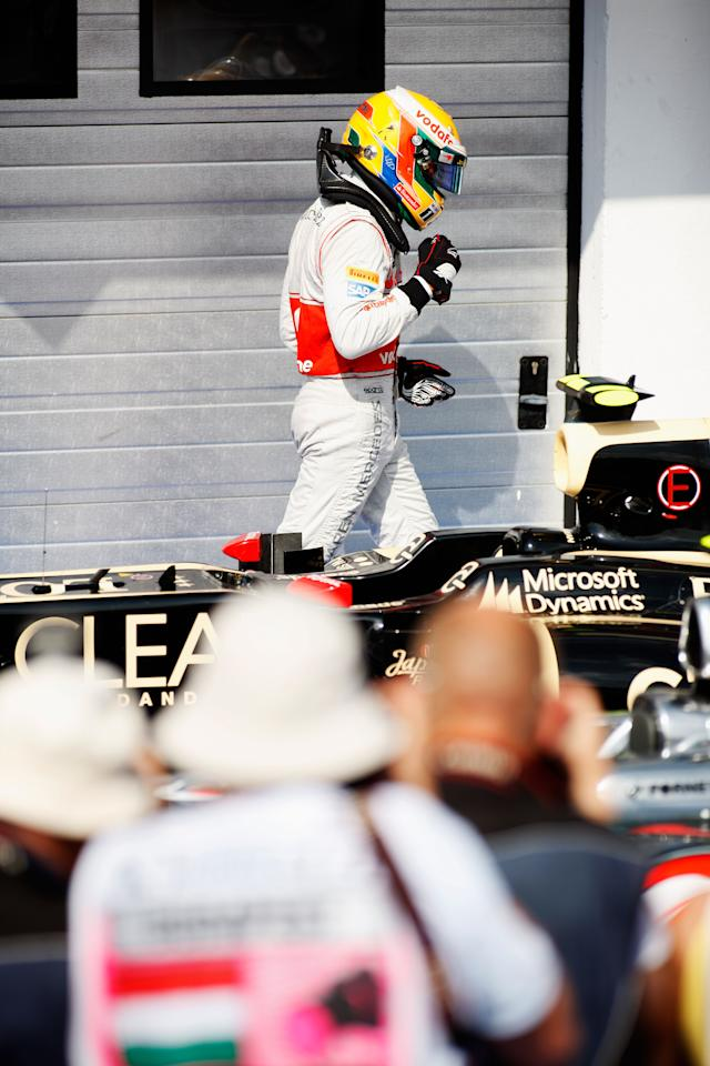 BUDAPEST, HUNGARY - JULY 29:  Lewis Hamilton of Great Britain and McLaren celebrates in parc ferme after finishing first during the Hungarian Formula One Grand Prix at the Hungaroring on July 29, 2012 in Budapest, Hungary.  (Photo by Drew Gibson/Getty Images)