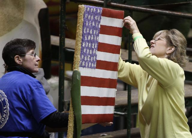 Volunteers at Phoenix Decorating work on an American flag that will be on a Tournament of Roses Parade float in Pasadena, California December 29, 2013. REUTERS/Jonathan Alcorn