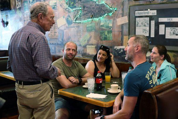 PHOTO: Democratic presidential candidate Mike Bloomberg speaks with people eating breakfast at El Pub Restaurant in the Little Havana neighborhood, in Miami, March 3, 2020. (Joe Raedle/Getty Images)