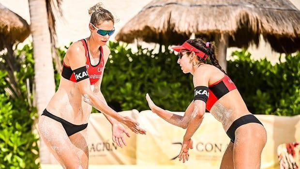 Sarah Pavan, left, and Melissa Humana Paredes, right, improved to 3-0 this season and 8-2 lifetime against fellow Canadians Heather Bansley and Brandie Wilkerson with a two-set victory in pool play Saturday at a FIVB 4-star beach volleyball event in Cancun, Mexico. (Submitted by FIVB - image credit)