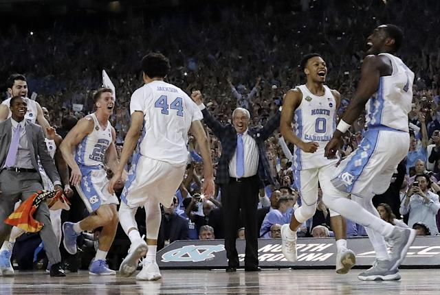 <p>North Carolina head coach Roy Williams and players celebrate after the finals of the Final Four NCAA college basketball tournament against Gonzaga, Monday, April 3, 2017, in Glendale, Ariz. North Carolina won 71-65. (AP Photo/David J. Phillip) </p>