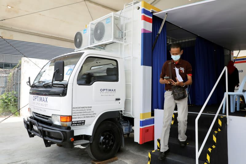 Man leaves after receiving a dose of the Sinovac vaccine against the COVID-19 in Kuala Lumpur
