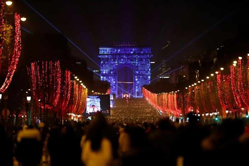 People wait for the new year's eve fireworks at the Arc de Triomphe at Champs Elysees in Paris, France on December 31, 2019. | Zakaria Abdelkafi—Anadolu Agency/Getty Images