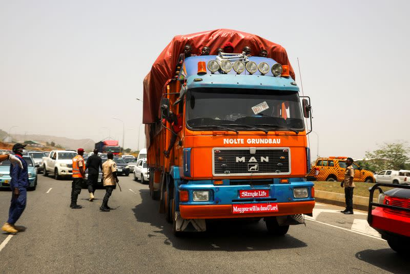 A truck transporting food is checked in Abuja