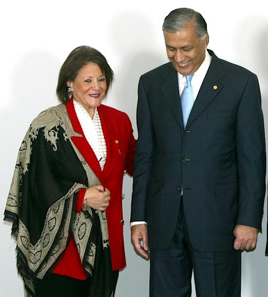 FILE - In this May 13, 2006, file photo, Egypt's Minister of International Cooperation Fayza Aboulnaga, left, and Pakistanian's Prime Minister Shaukat Aziz smile during a photo call shortly before the opening ceremony of the Developing Eight Summit in Nusa Dua, Bali island, Indonesia. Former U.S. Ambassador to Egypt Francis Ricciardone wrote in a secret State Department memo in March 2008 that Aboulnaga continued to complain about U.S. money for unlicensed democracy groups that trained political activists. Ricciardone was worried that the groups, which he called partners, could be targeted by the minister, who opposed the U.S. financing of the groups unless the money went through her office.Two months before Egyptian police stormed the offices of U.S.-backed democracy organizations in 2011, 7 Egyptian employees resigned from one of the American groups to protest what they called very undemocratic practices. Interviews and documents obtained by The Associated Press show that the workers' protest and the broader government crackdown with the raids helped expose what U.S. officials do not want to admit publicly: the American government spent tens of millions of dollars financing and training liberal groups in Egypt, the backbone of the Egyptian uprising. This was done to build opposition to Islamic and pro-military parties in power - all in the name of democracy development. And, all while American diplomats were assuring Egyptian leaders the U.S. was not taking sides. (AP Photo/Mast Irham, Pool)
