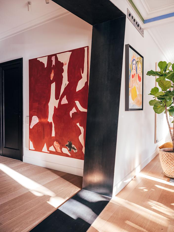 "<div class=""caption""> Juan's apartment is full of off angles and unexpected pairings. When viewed from this vantage point, paintings by <a href=""https://albertrieragalceran.com/"" rel=""nofollow noopener"" target=""_blank"" data-ylk=""slk:Albert Riera Galceran"" class=""link rapid-noclick-resp"">Albert Riera Galceran</a> (left) and <a href=""https://www.instagram.com/fayeweiwei/?hl=en"" rel=""nofollow noopener"" target=""_blank"" data-ylk=""slk:Faye Wei Wei"" class=""link rapid-noclick-resp"">Faye Wei Wei</a> (right) have a coalescing effect. </div>"