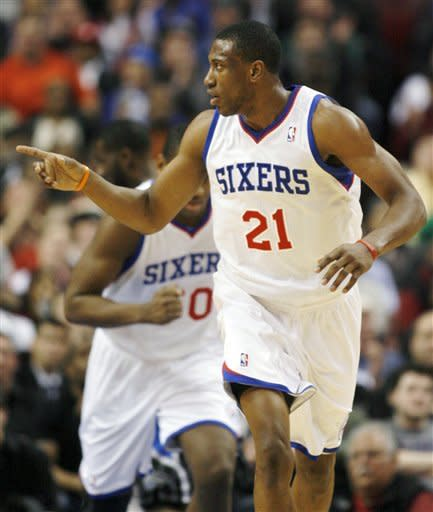 Philadelphia 76ers' Thaddeus Young (21) reacts to scoring against the Orlando Magic in the first half of an NBA basketball game, Monday, Jan. 30, 2012, in Philadelphia. The 76ers won 74-69. (AP Photo/H. Rumph Jr )