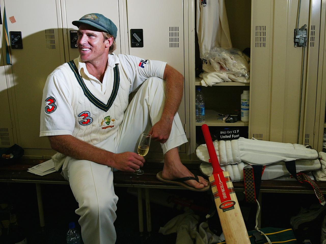 PERTH, AUSTRALIA - OCTOBER 10:  Matthew Hayden of Australia relaxes in the rooms after scoring 380 to break Brian Lara of The West Indies world record of 375 during day two of the First Test between Australia and Zimbabwe played at the WACA Ground on October 10, 2003 in Perth, Australia. (Photo by Hamish Blair/Getty Images)