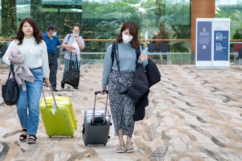 A female traveller seen wearing a face mask at Changi Airport Terminal 3 on 6 February 2020. (PHOTO: Dhany Osman / Yahoo News Singapore)