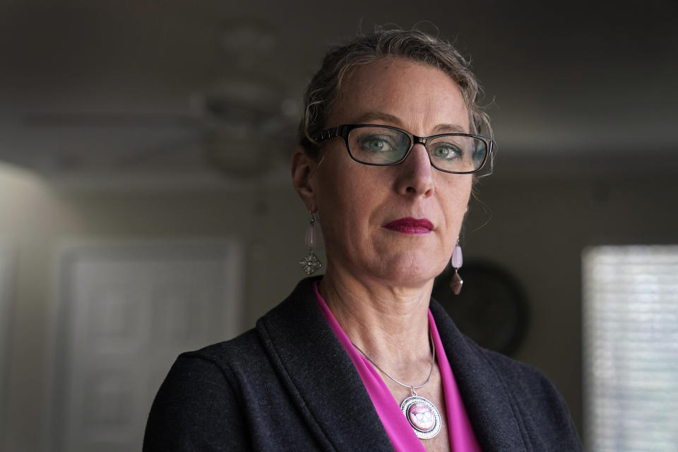 Susanna Schmitt Williams poses at her home in Chapel Hill, N.C., Thursday, Feb. 25, 2021. Williams, the former chief of the Carrboro Fire Department, considered suicide after enduring harassment in her department despite becoming chief. Advocates for female firefighters say their struggles are part of a larger trend, as evidenced by recent gender discrimination lawsuits against fire departments in Illinois, Virginia, and Texas. (AP Photo/Gerry Broome)