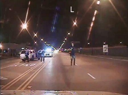 FILE PHOTO - Laquan McDonald (R) walks on a road before he was shot 16 times by police officer Jason Van Dyke in Chicago, in this still image taken from a police vehicle dash camera video shot on October 20, 2014, and released by Chicago Police on November 24, 2015. REUTERS/Chicago Police Department/Handout via Reuters