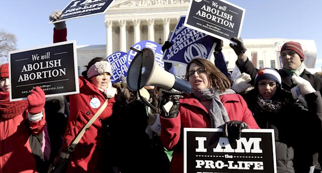 Both sides of the national abortion argument, plus free-speech rights, are at the center of Supreme Court case NIFLA v. Becerra, which began oral arguments on Tuesday. (Photo: Susan Walsh/AP/REX/Shutterstock)