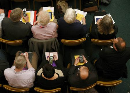 A member of The Church of England's General Synod prepares to vote at Church House in central London November 20, 2013. REUTERS/Andrew Winning